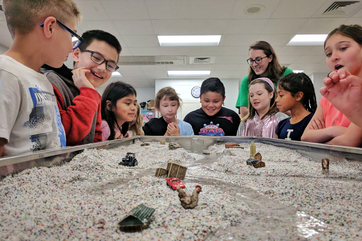 Kids amazed by our stream table